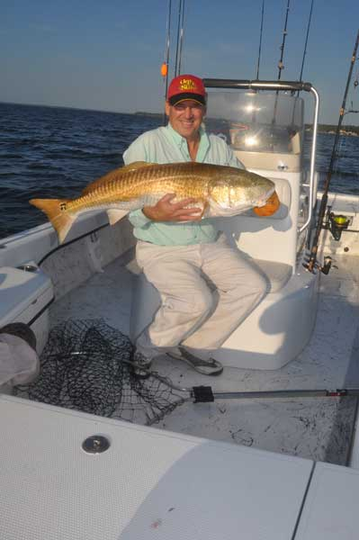 Mike with a 42-inch red drum caught while fishing the Neuse River near Oriental with Gary Dubiel.